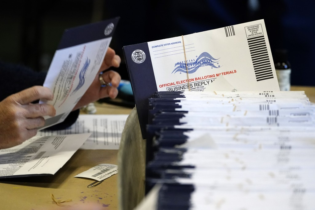 FILE - In this Nov. 4, 2020, file photo, Chester County, Pa. election workers process mail-in and absentee ballots at West Chester University in West ...