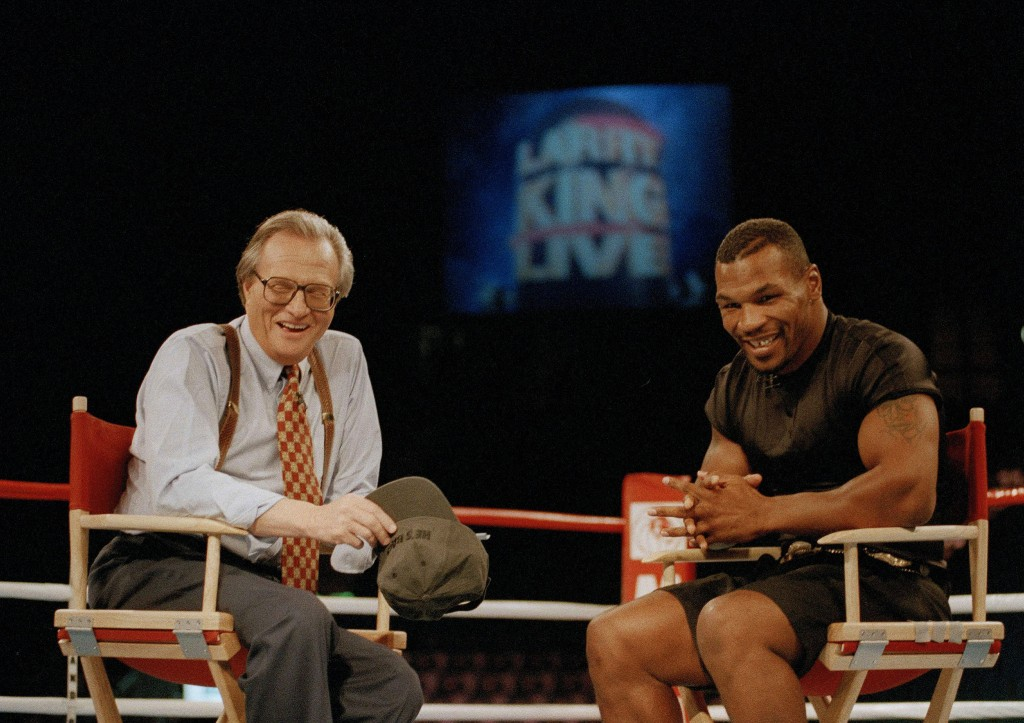 FILE - In this Aug. 16, 1995 file photo, former heavyweight champion Mike Tyson, right, shares a laugh with TV talk show host Larry King during the br...