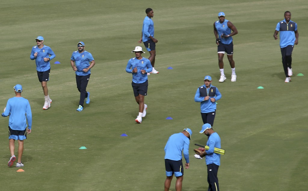 Players of South Africa cricket team warm up during a practice session at the National Cricket Stadium, in Karachi, Pakistan, Saturday, Jan. 23, 2021....