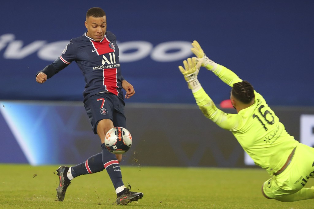 PSG's Kylian Mbappe scores his side's opening goal during the French League One soccer match between Paris Saint-Germain and Montpellier at the Parc d...