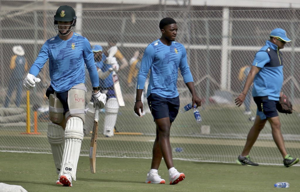 South Africa's Dean Elgar, left, and Lutho Sipamla, center, attend a practice session at the National Cricket Stadium, in Karachi, Pakistan, Saturday,...