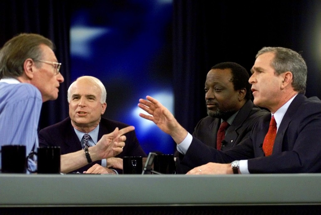 FILE - In this Feb. 15, 2000 file photo, Larry King, host of CNN's Larry King Live, asks a question to the Republican presidential candidates, from le...