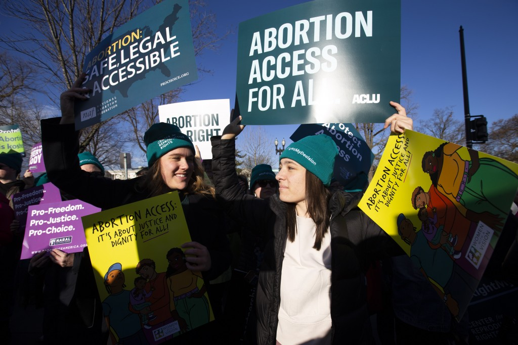 Abortion rights demonstrators rally outside of the U.S. Supreme Court in Washington, Wednesday, March 4, 2020. Among abortion-rights activists, there'...
