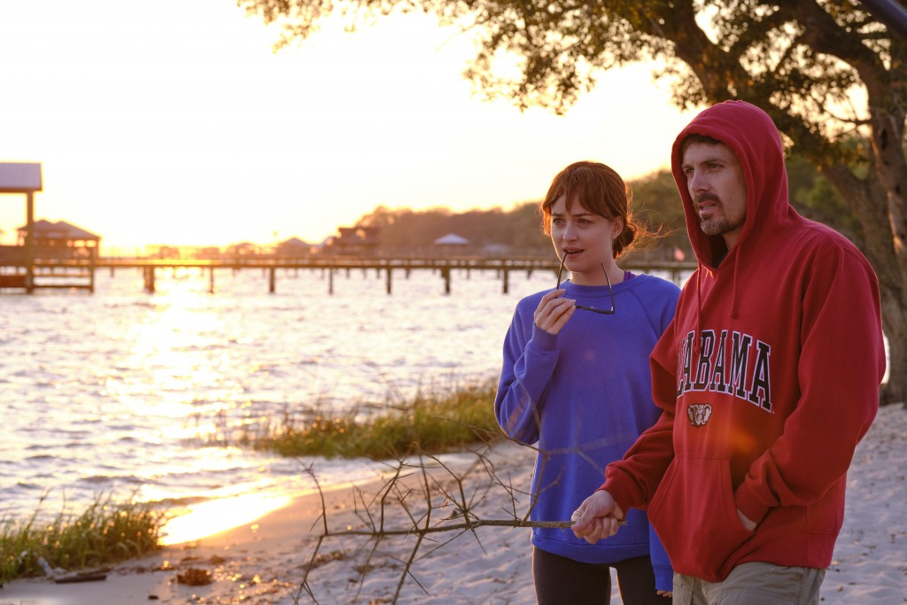 """This image released by Gravitas Ventures shows Dakota Johnson, left, and Casey Affleck in a scene from """"Our Friend."""" (Claire Folger/Gravitas Ventures ..."""