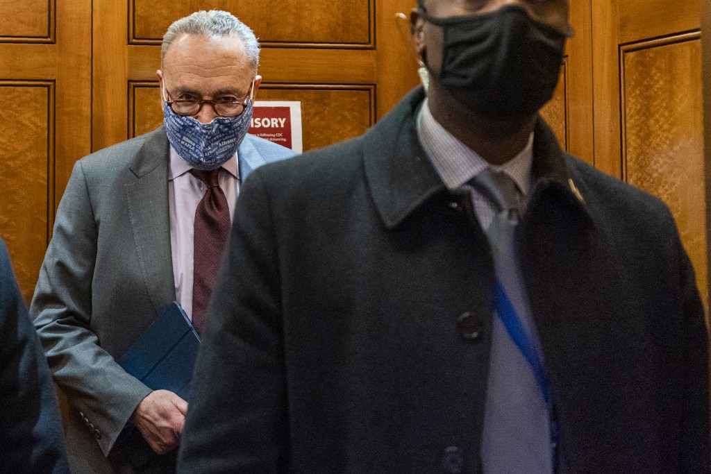 Senate Majority Leader Chuck Schumer of N.Y, takes the elevator in the U.S. Capitol, Friday, Jan. 22, 2021, in Washington. It's taken only days for De...