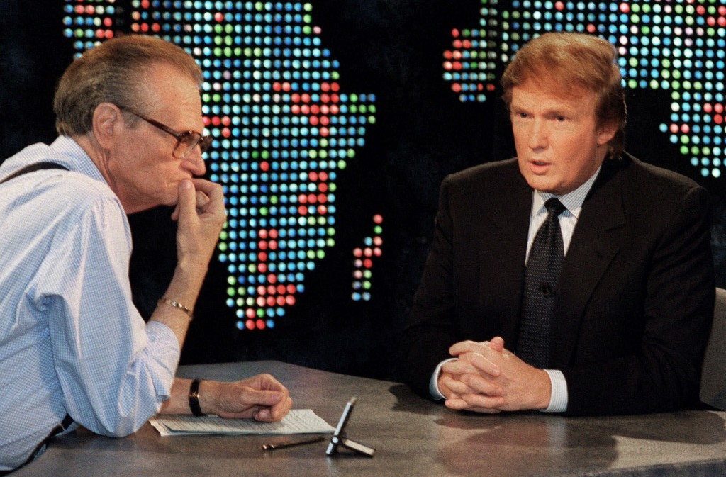 """FILE - In this Oct. 7, 1999 file photo, Donald Trump, right, is interviewed by Larry King during a taping of """"Larry King Live,""""  in New York.  King, w..."""