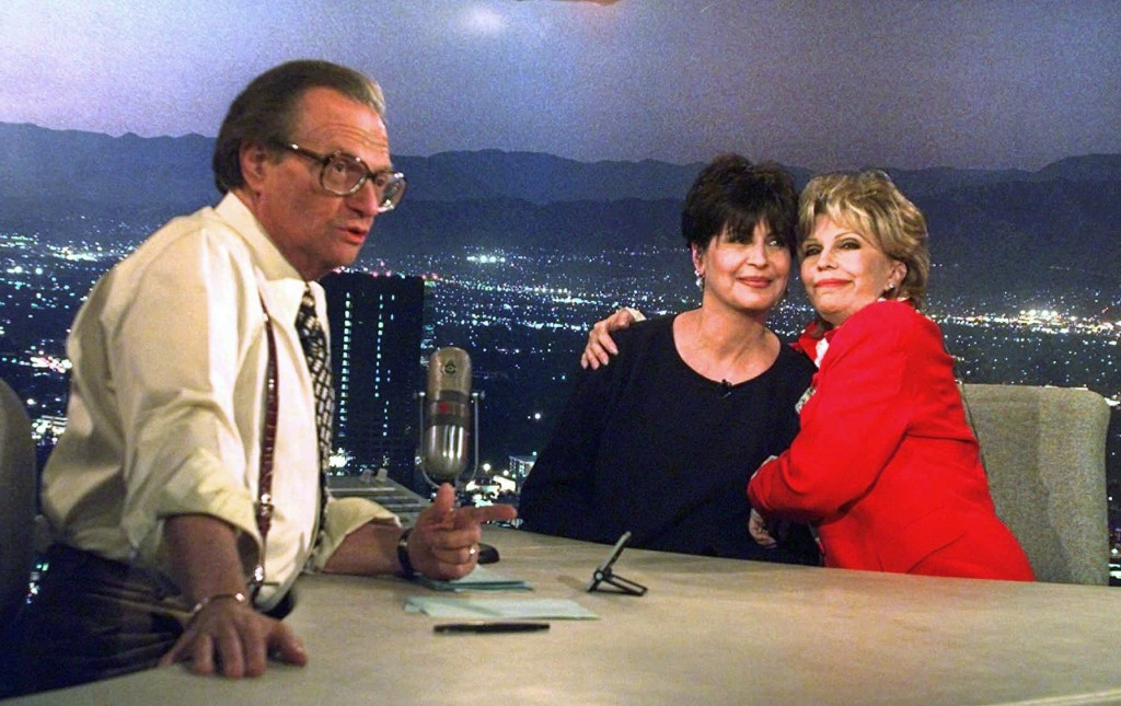 FILE - In this Dec. 12, 1997 file photo, Tina Sinatra, center, and Nancy Sinatra, right, daughters of the singer Frank Sinatra, joke around on CNN's L...
