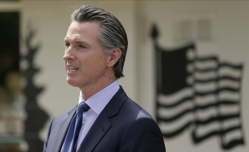 FILE - In this Friday, May 22, 2020, file photo, California Gov. Gavin Newsom speaks during a news conference at the Veterans Home of California in Yo...