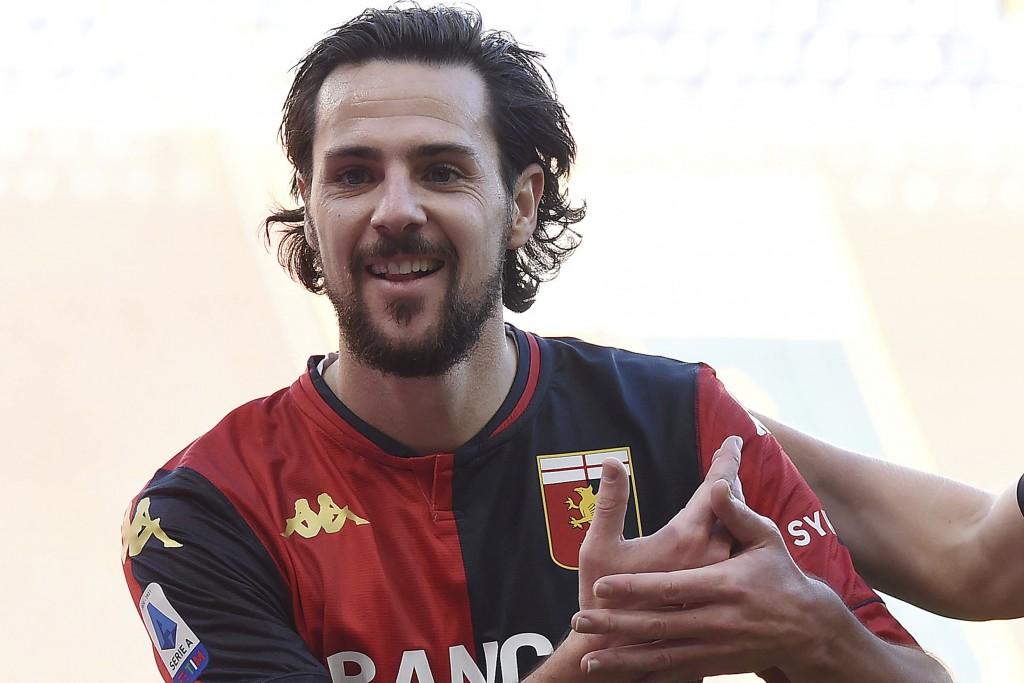 Genoa's Mattia Destro celebrates after scoring during the Serie A soccer match between Genoa and Cagliari at the Luigi Ferraris Stadium in Genoa, Ital...