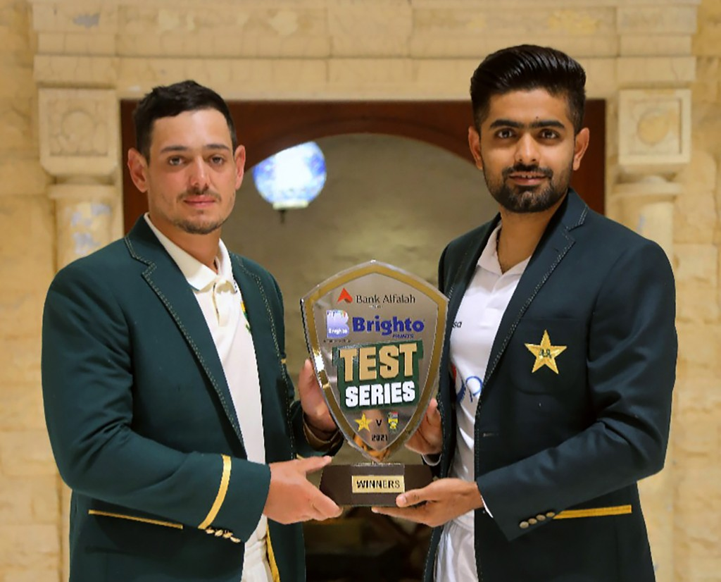 In this photo provided by Pakistan Cricket Board, Pakistan cricket team's skipper, Babar Azam, right, and his South Africa's counterpart Quinton de Ko...