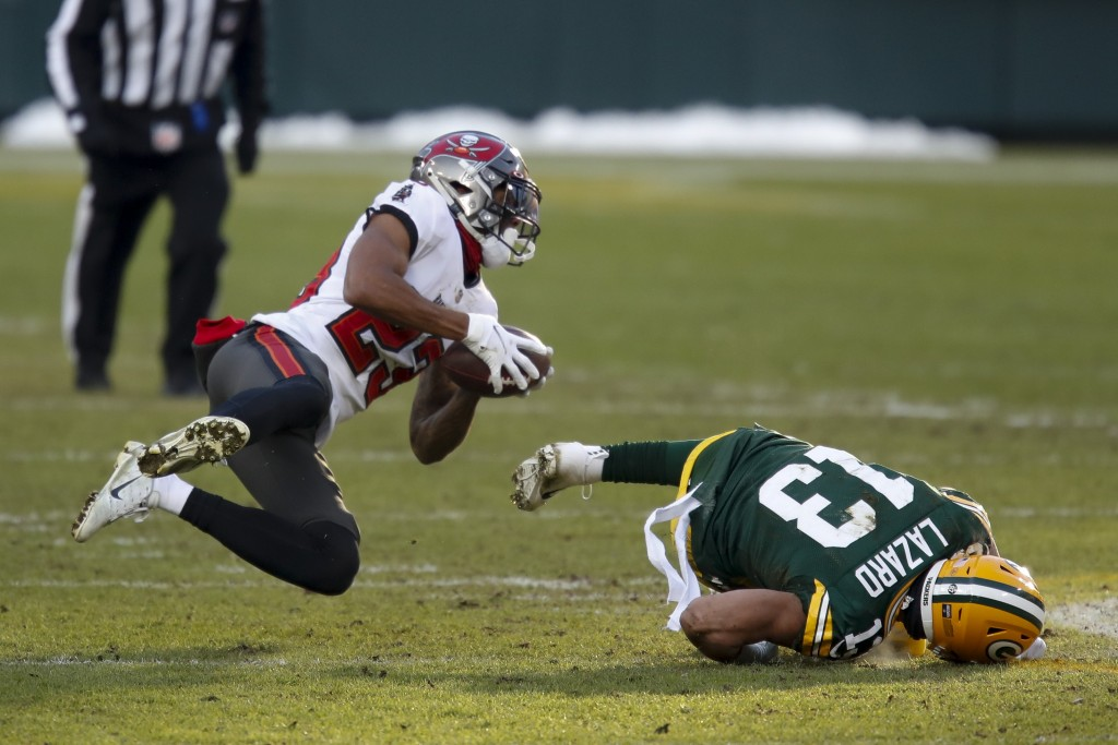 Tampa Bay Buccaneers' Sean Murphy-Bunting intercepts a pass intended for Green Bay Packers' Allen Lazard during the first half of the NFC championship...