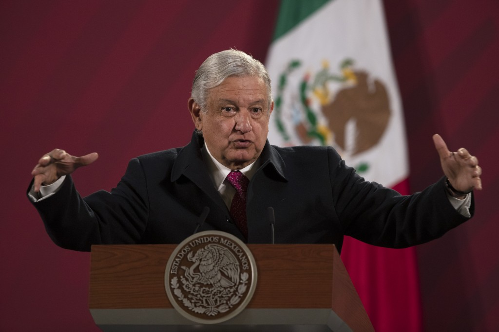 FILE - In this Dec. 18, 2020 file photo, Mexican President Andres Manuel Lopez Obrador gives his daily, morning news conference at the presidential pa...