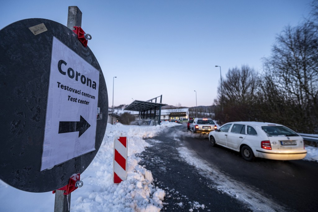 Cars queue in front of a Corona test station at the German-Czech Republic border in Furth im Wald, Germany, Monday, Jan. 25, 2021. German police say h...