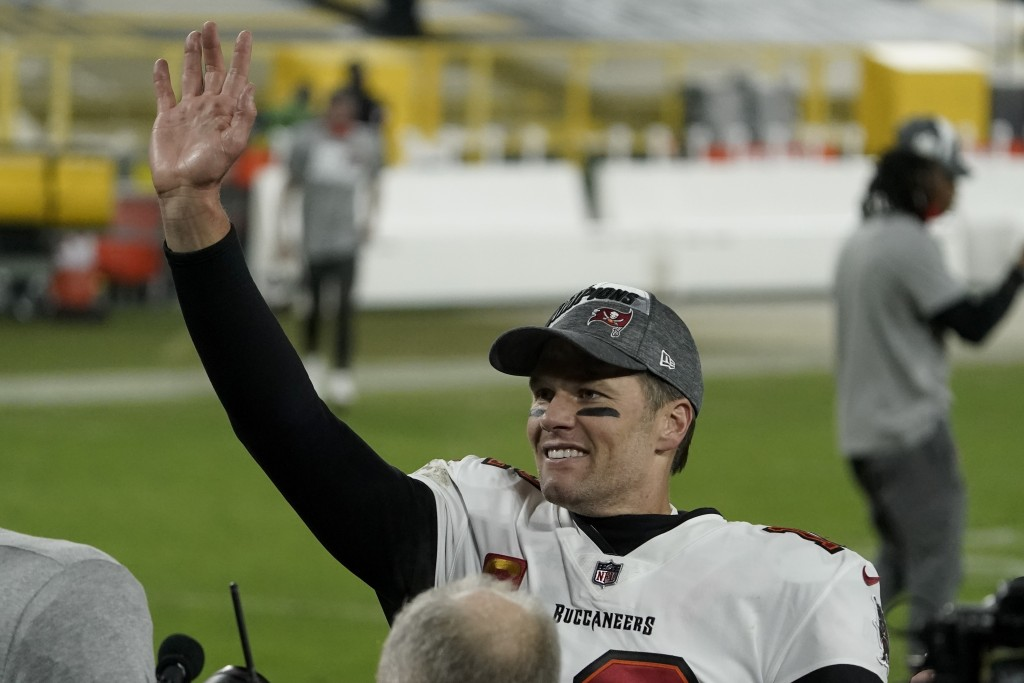 Tampa Bay Buccaneers quarterback Tom Brady waves to spectators after winning the NFC championship NFL football game against the Green Bay Packers in G...