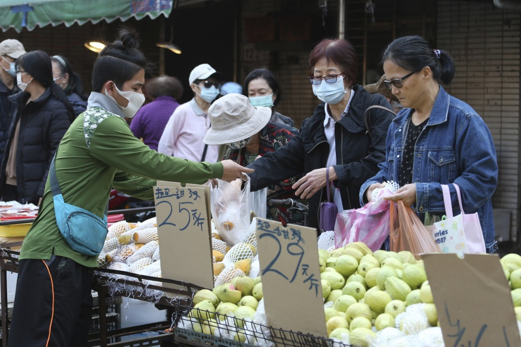 People wear face masks to help curb the spread of the coronavirus as they shop at a market in Taipei, Taiwan, Monday, Jan. 25, 2021. (AP Photo/Chiang ...