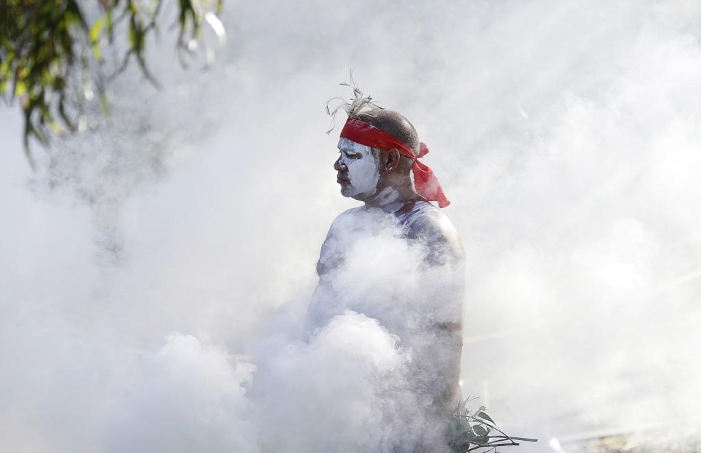 Russell Dawson of the Koomurri Aboriginal Dancers participates in a smoking ceremony during Australia Day ceremonies in Sydney, Tuesday, Jan. 26, 2021...