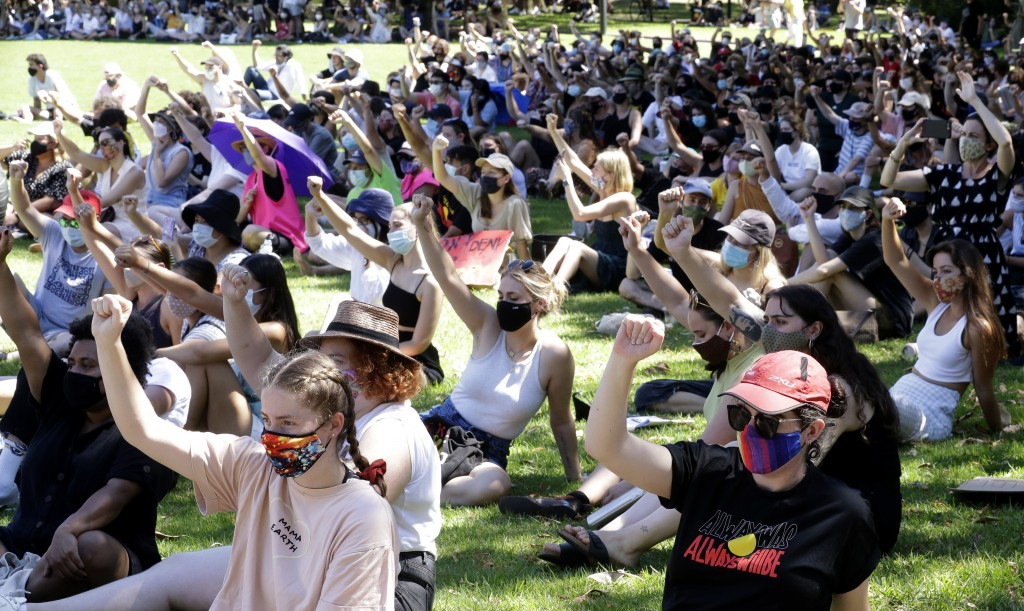 Members of the crowd raise their fists during an Aboriginal-lead Invasion Day rally on Australia Day in Sydney, Tuesday, Jan. 26, 2021. Many of Austra...