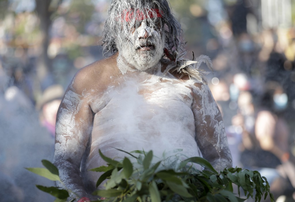 A member of the Koomurri Aboriginal Dancers participates in a smoking ceremony during Australia Day ceremonies in Sydney, Tuesday, Jan. 26, 2021. (AP ...
