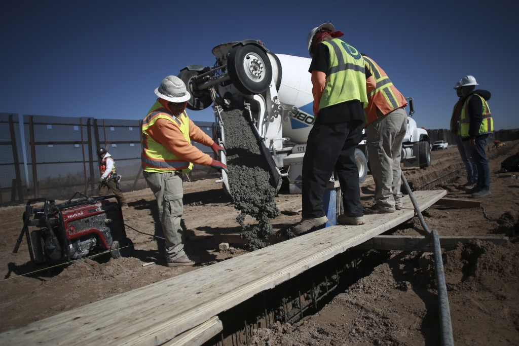 FILE - In this Jan. 12, 2021, file photo, workers prepare the foundation for a steel section of border wall that will be built on the Mexican side of ...