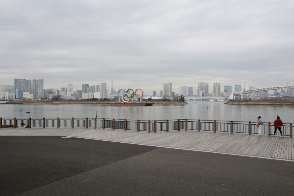 The Olympic rings are seen at the empty Odaiba waterfront in Tokyo, Tuesday, Jan. 26, 2021. The Tokyo Games, postponed in the midst of a pandemic, are...