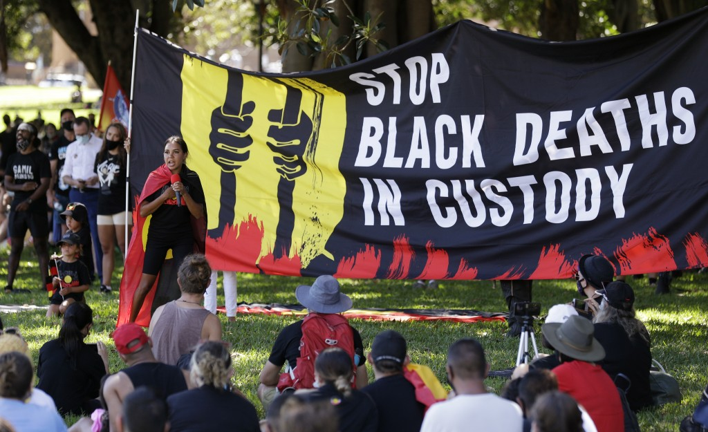 A speaker addresses a crowd during an Aboriginal-lead Invasion Day rally on Australia Day in Sydney, Tuesday, Jan. 26, 2021. Many of Australia's First...
