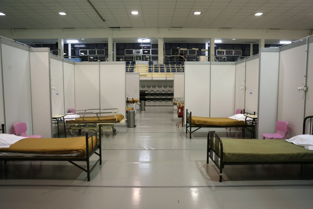 FILE - In this Jan. 20, 2021, file photo, beds are ready to receive the first patients at a field hospital set up in a sports hall in Lisbon. In its f...