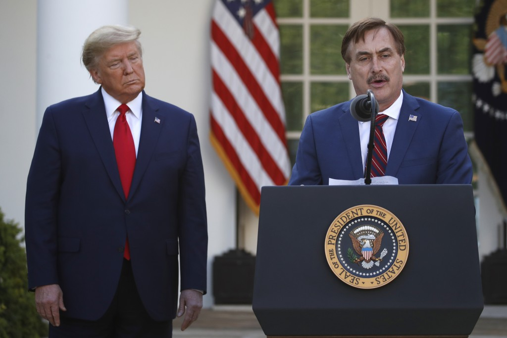 FILE - In this March 30, 2020, file photo, My Pillow CEO Mike Lindell speaks as President Donald Trump listens during a briefing about the coronavirus...