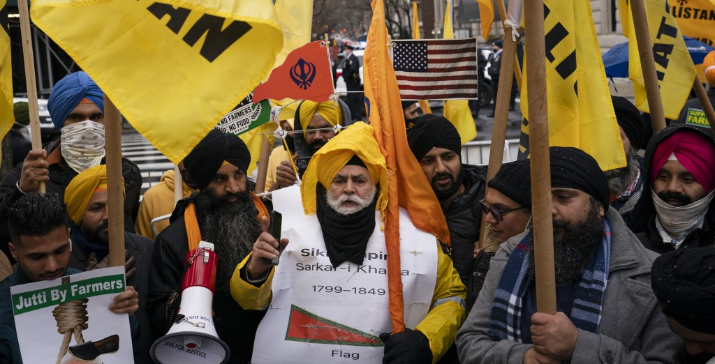 Protesters gather on Fifth Avenue after NYPD officer closed down the street outside the Consulate General of India, Tuesday, Jan. 26, 2021, in the Man...