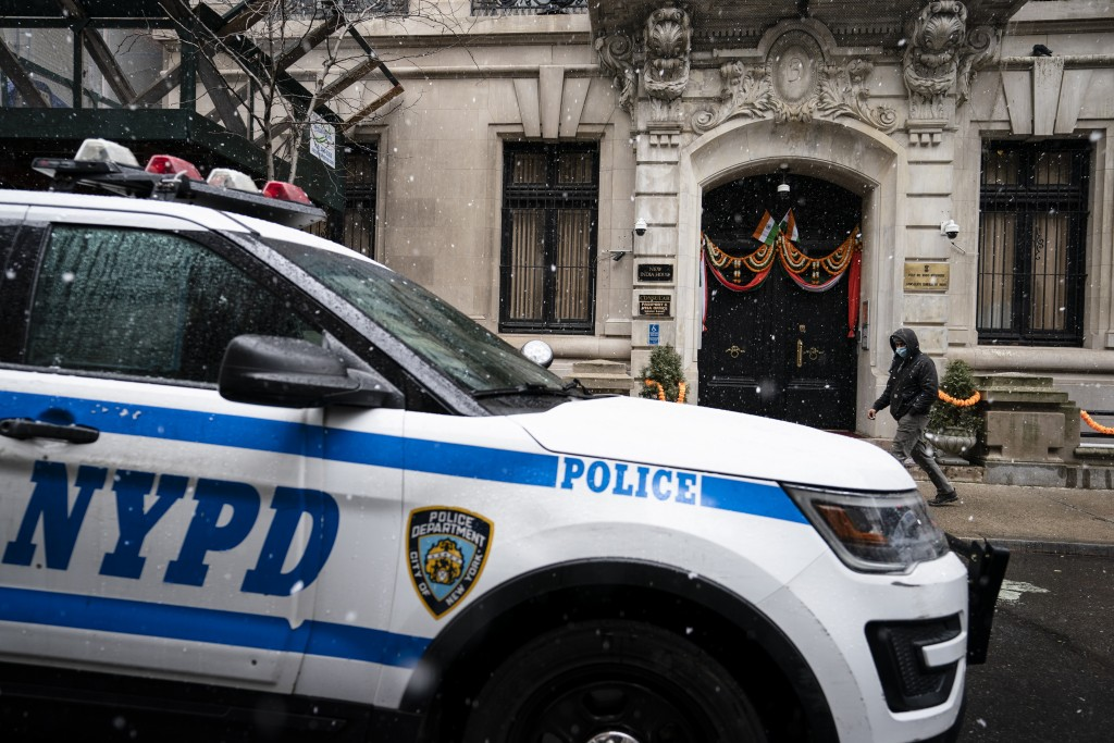 New York Police Department vehicles park outside the Consulate General of India during a protest, Tuesday, Jan. 26, 2021, in the Manhattan borough of ...