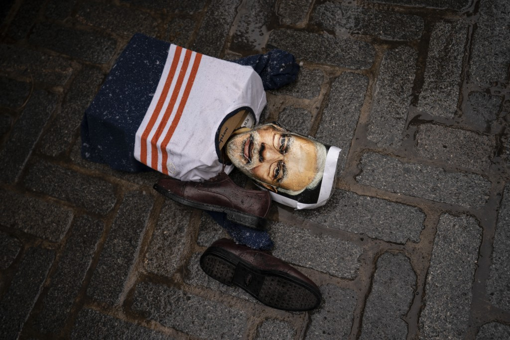An effigy of Narendra Modi, prime minister of India, lies on the ground as protesters gather outside the Consulate General of India, Tuesday, Jan. 26,...
