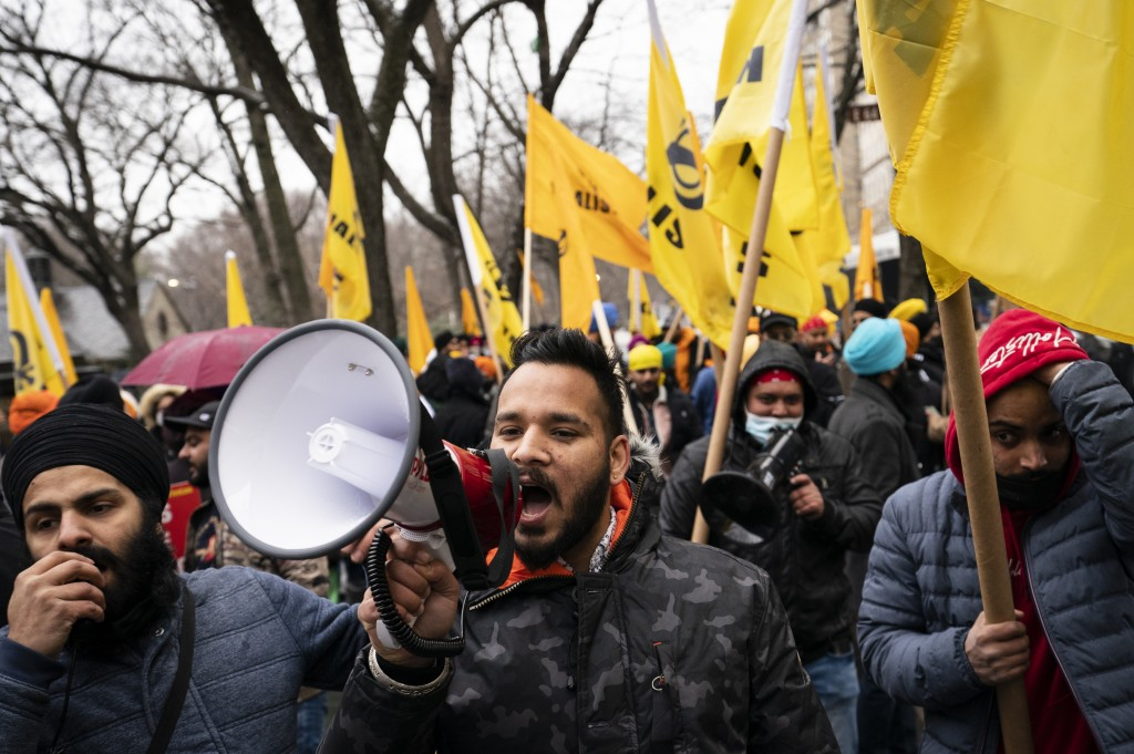 Protesters lead a chant on Fifth Avenue outside the Consulate General of India, Tuesday, Jan. 26, 2021, in the Manhattan borough of New York. Tens of ...
