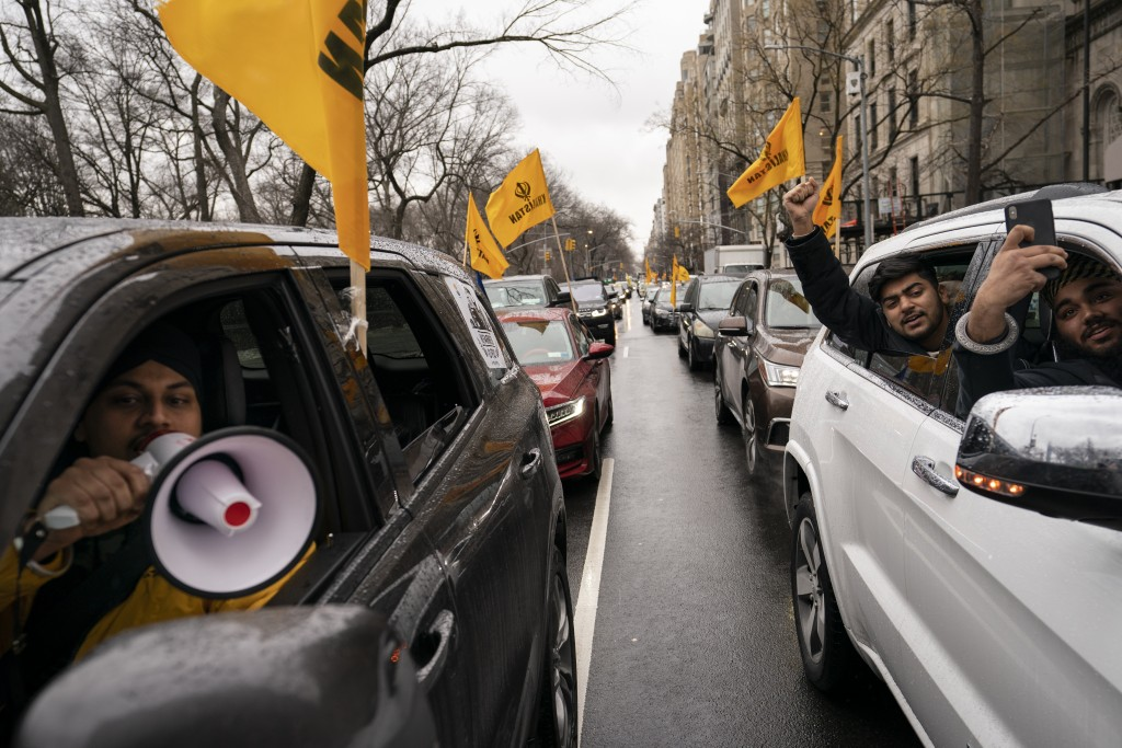 A convoy of protesters drive down Fifth Avenue past the Consulate General of India, Tuesday, Jan. 26, 2021, in the Manhattan borough of New York. Tens...