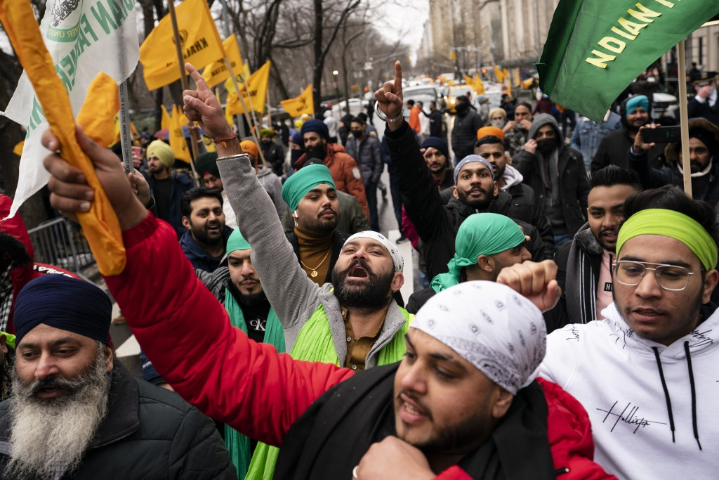 Protesters chant on Fifth Avenue outside the Consulate General of India, Tuesday, Jan. 26, 2021, in the Manhattan borough of New York. Republic Day ma...