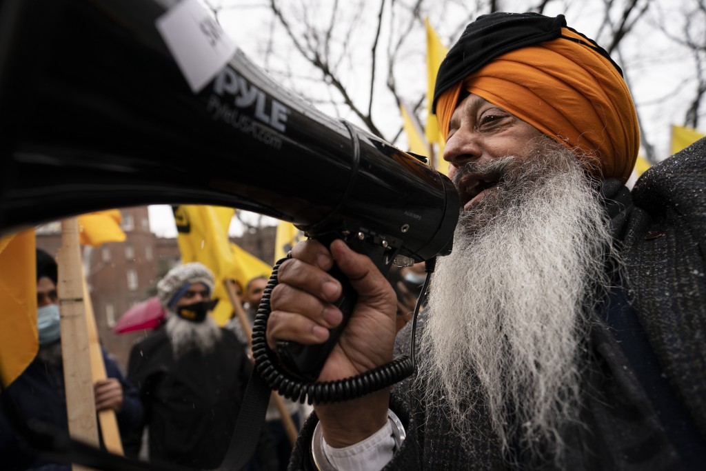 Protesters lead chants outside the Consulate General of India, Tuesday, Jan. 26, 2021, in the Manhattan borough of New York. Tens of thousands of prot...