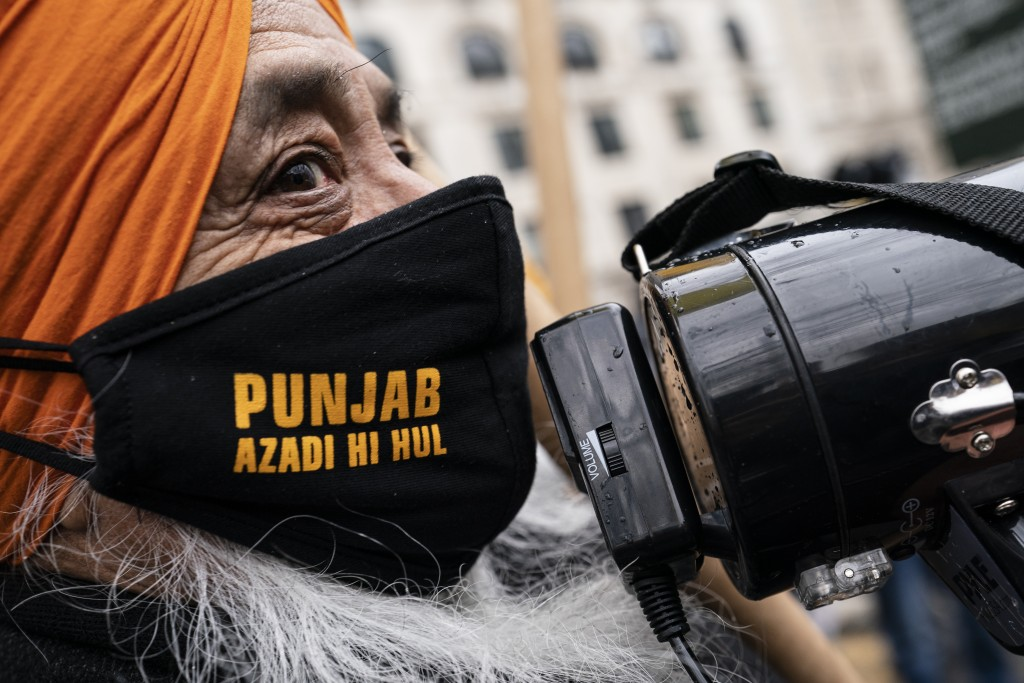 Protesters gather outside the Consulate General of India, Tuesday, Jan. 26, 2021, in the Manhattan borough of New York. Tens of thousands of protestin...