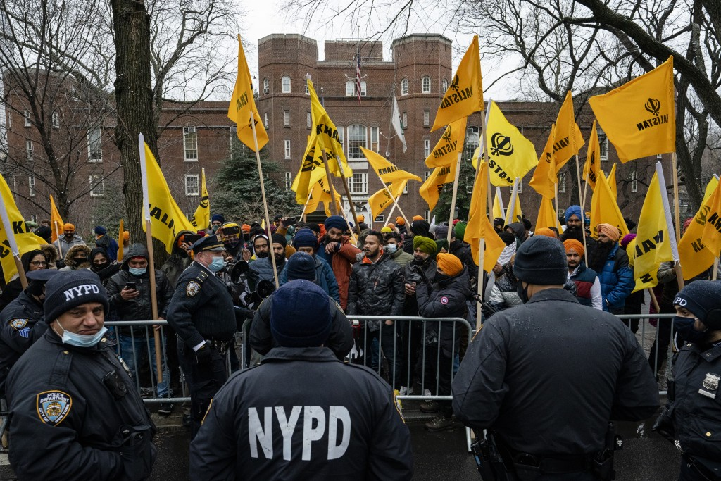Protesters gather behind an NYPD barricade on Fifth Avenue outside the Consulate General of India, Tuesday, Jan. 26, 2021, in the Manhattan borough of...
