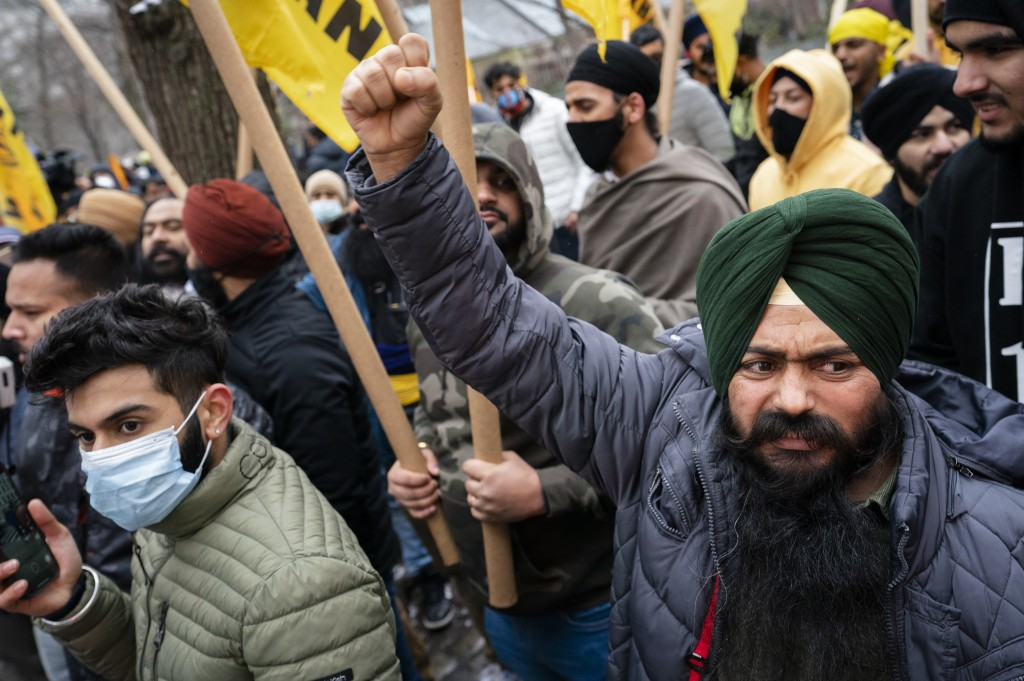 Protesters gather on Fifth Avenue outside the Consulate General of India, Tuesday, Jan. 26, 2021, in the Manhattan borough of New York. Tens of thousa...