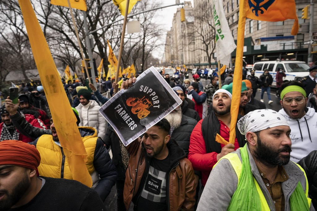 Protesters lead a chant while gathering on Fifth Avenue outside the Consulate General of India, Tuesday, Jan. 26, 2021, in the Manhattan borough of Ne...