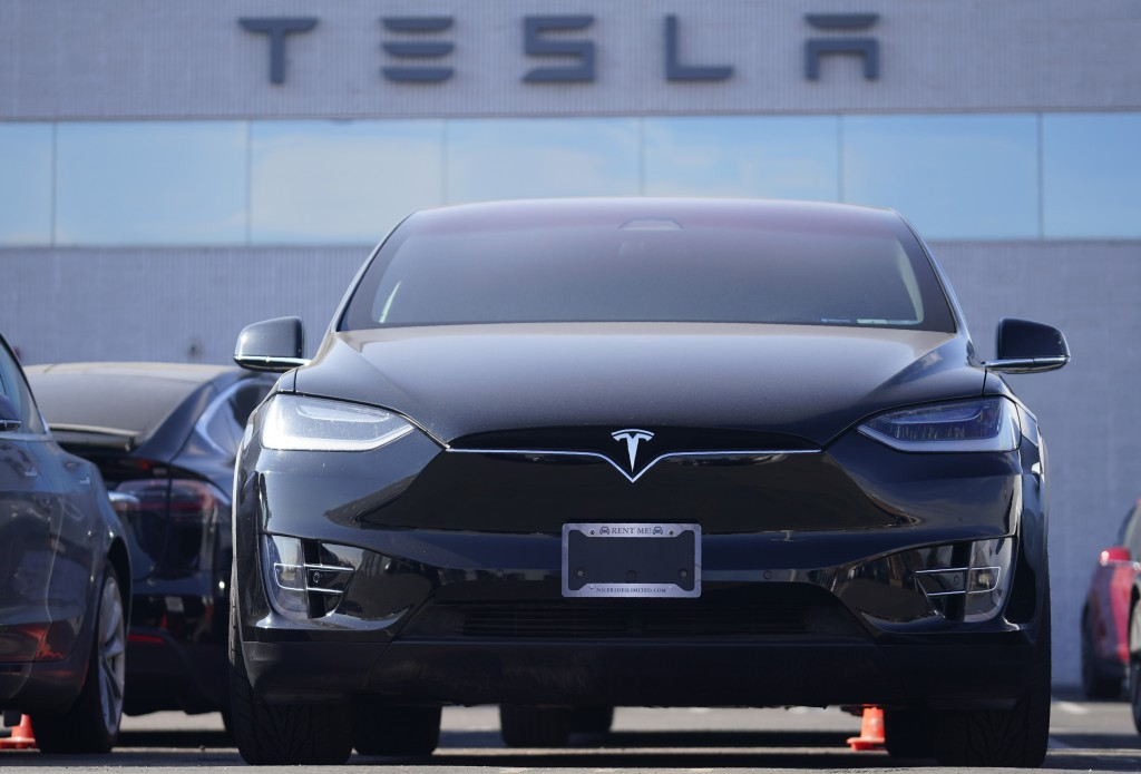 An unsold 2021 Model X sports-utility vehicle sits at a Tesla dealership Sunday, Jan. 24, 2021, in Littleton, Colo. (AP Photo)