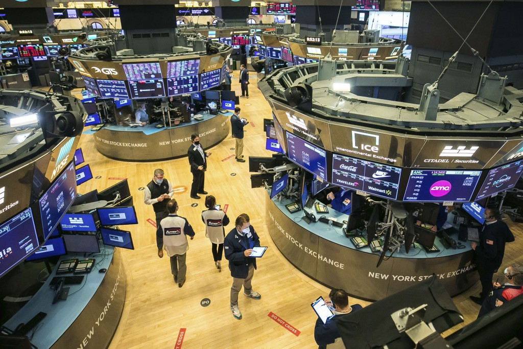 In this photo provided by the New York Stock Exchange, traders work on the floor, Wednesday, Jan. 27, 2021. Stocks were broadly lower in afternoon tra...