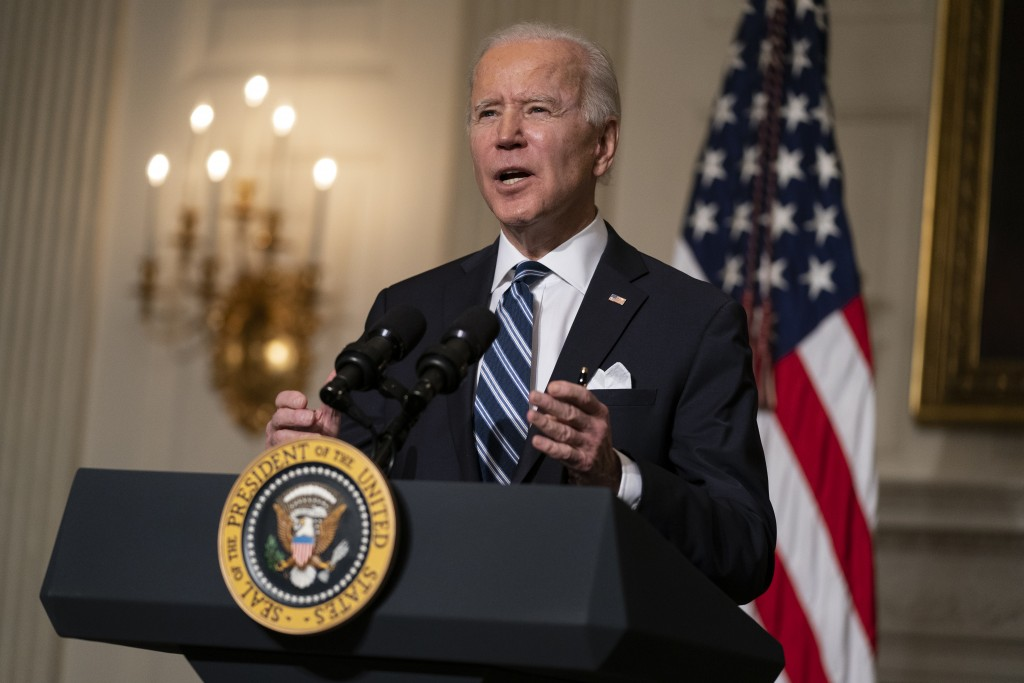 President Joe Biden delivers remarks on climate change and green jobs, in the State Dining Room of the White House, Wednesday, Jan. 27, 2021, in Washi...