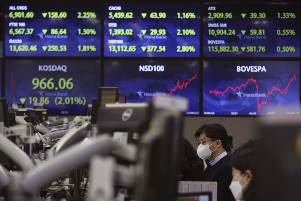 A currency trader watches monitors at the foreign exchange dealing room of the KEB Hana Bank headquarters in Seoul, South Korea, Thursday, Jan. 28, 20...