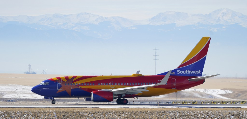 FILE - In this Dec. 31, 2020 file photo, a Southwest Airlines jetliner taxis down a runway for takeoff from Denver International Airport in Denver.  S...