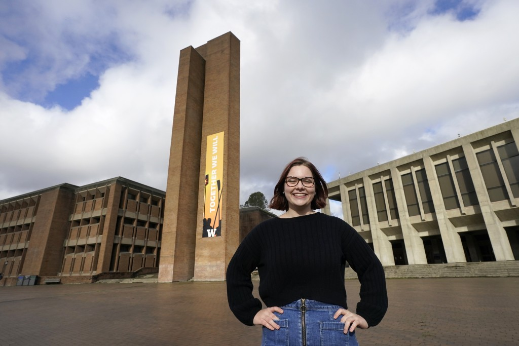 Sophie Corroon, a sophomore at the University of Washington, poses for a photo on the school's campus Monday, Jan. 25, 2021, in Seattle. Corroon helpe...