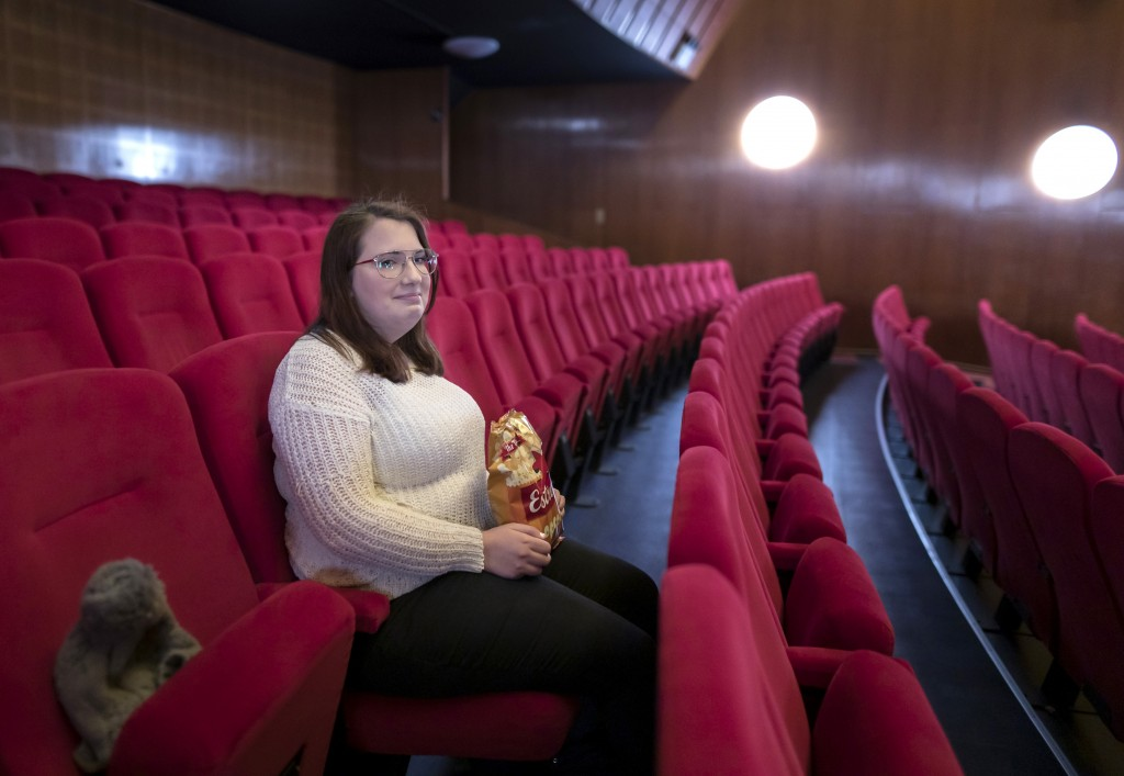 Malin Hellberg, sits alone to watch the film Tigrar, in Gothenburg, Sweden, on Saturday, Jan. 30, 2021. The 44th Goteborg film festival opened this we...