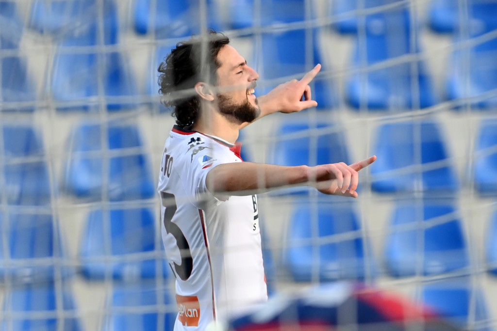 Genoa's Mattia Destro celebrates after scoring his side's third goal during the Italian Serie A soccer match between Crotone and Genoa, at the Ezio Sc...