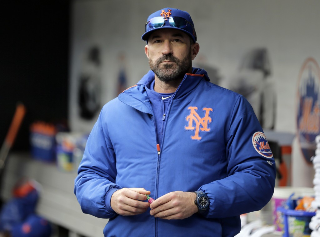 FILE - In this Sunday, April 28, 2019, file photo, then-New York Mets manager Mickey Callaway stands by the dugout before a baseball game against the ...