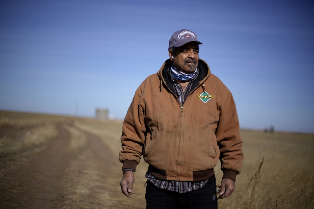 Rod Bradshaw stands in a field on his farm near Jetmore, Kan., Wednesday, Jan. 13, 2021. Bradshaw, who claims to be the last Black farmer in Hodgeman ...