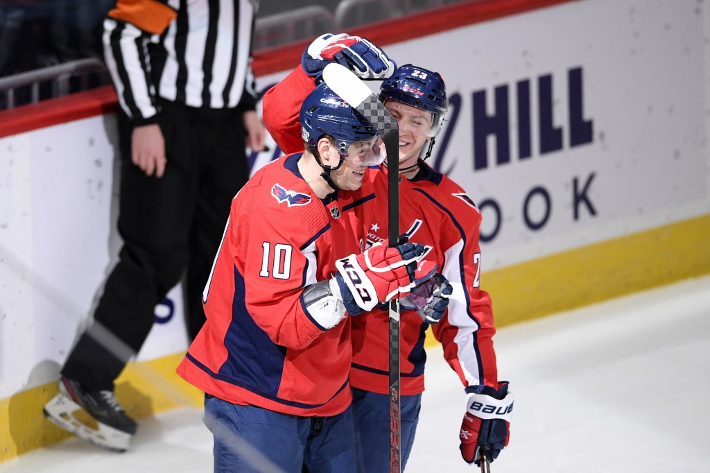 Washington Capitals right wing Daniel Sprong (10) celebrates his goal with center Michael Sgarbossa, back, during the first period of an NHL hockey ga...