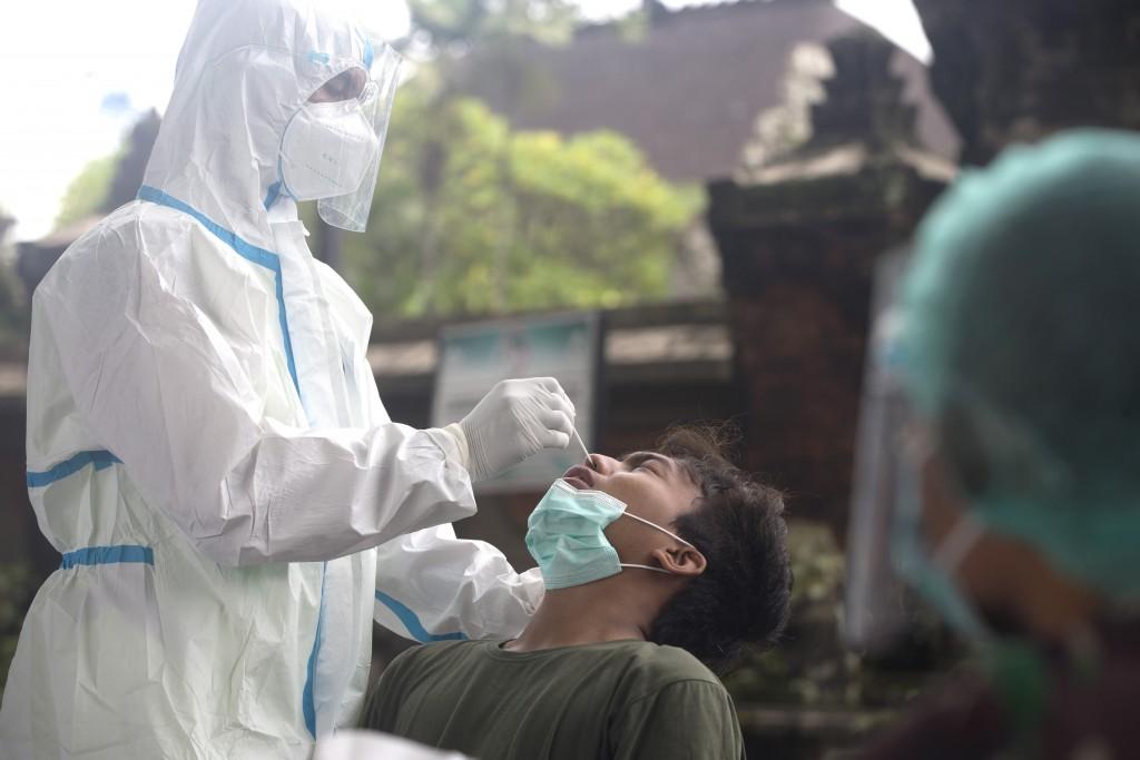 Health worker takes nasal swab samplefor coronavirus test in Denpasar, Bali on Feb. 2, 2021.